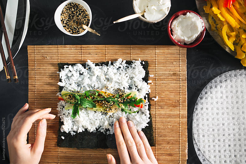 Woman Making Veggie Maki Sushi Rolls by Lumina for Stocksy United