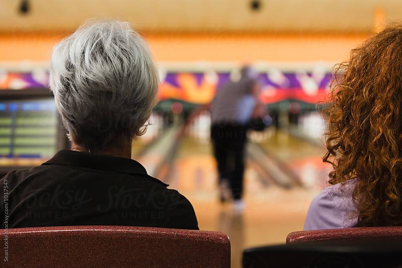 Bowling: Friends Watching Senior Male Bowler by Sean Locke for Stocksy United