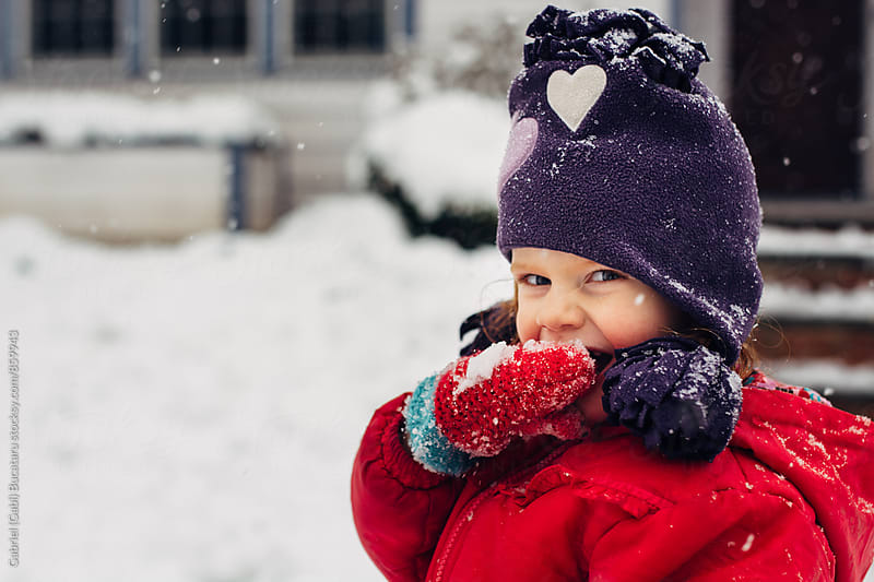 Cute smiling girl outside in snowy weather by Gabriel (Gabi) Bucataru for Stocksy United