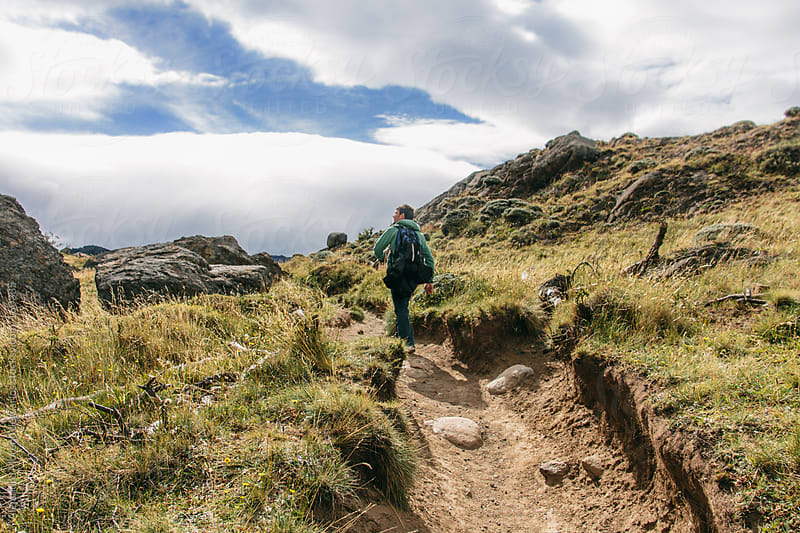 Hiker hiking on mountain trail in Patagonia. Chalten, Argentina by Alejandro Moreno de Carlos for Stocksy United