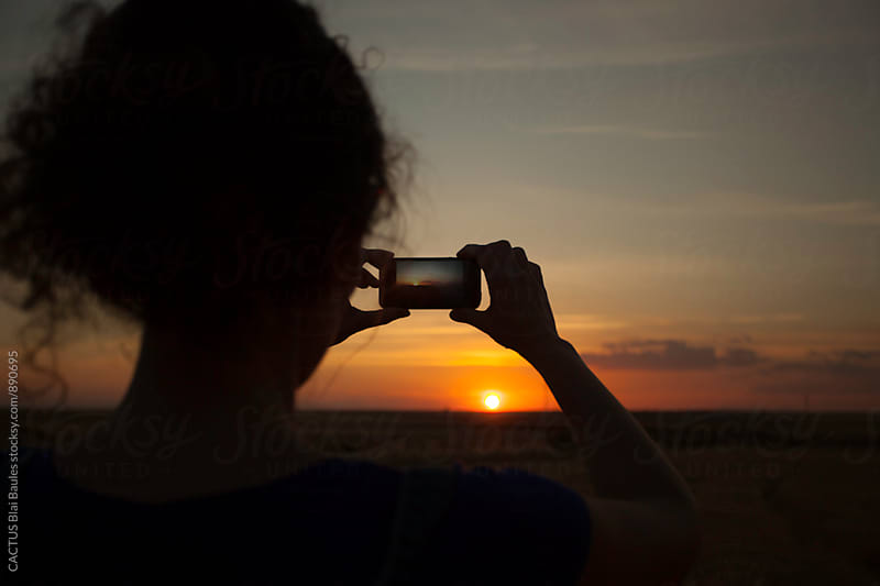 Taking a photo of the sunset by CACTUS Blai Baules for Stocksy United