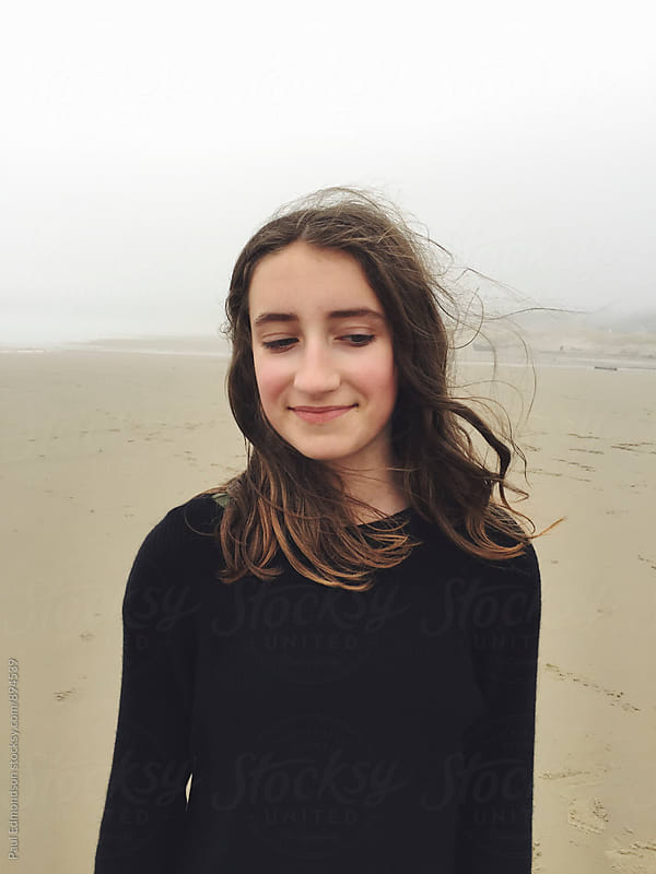 Portrait of twelve year old girl on beach, eyes closed by Paul Edmondson for Stocksy United