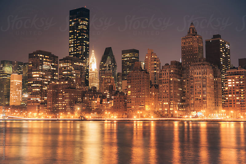 All that glitters - The New York City skyline at night by Vivienne Gucwa for Stocksy United
