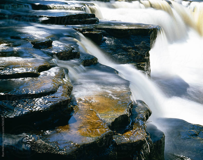 small water falls to side of Tahquamenon Falls waterfall closeup cascades rapids by Ron Mellott for Stocksy United