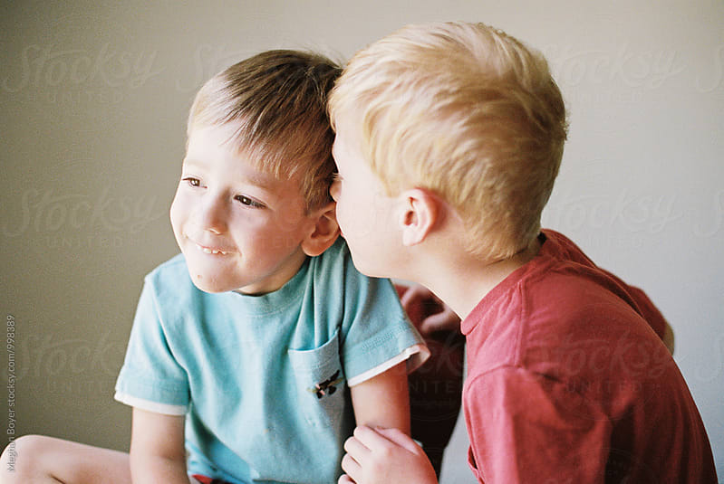 Young Brothers Playing and being silly next to each other by Meghan Boyer for Stocksy United