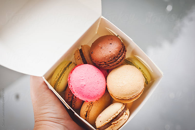 macarons in a takeaway box by Gillian Vann for Stocksy United