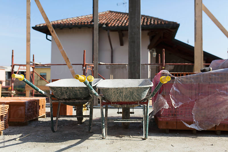 Two wheelbarrows on terrace under construction by Laura Stolfi for Stocksy United