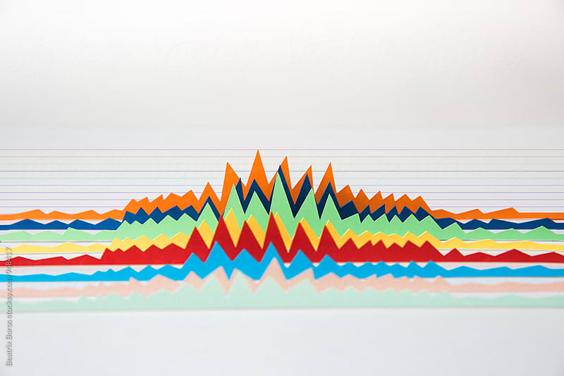 Colorful 3D diagrams on striped background by Beatrix Boros for Stocksy United