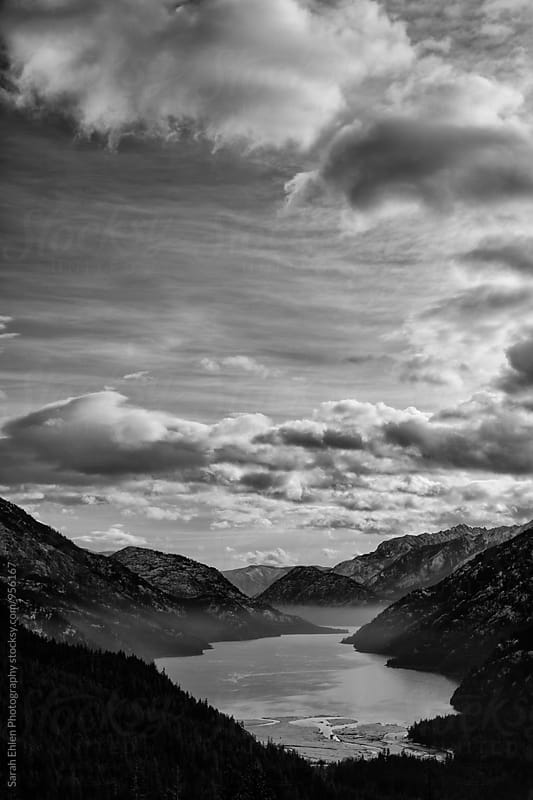 A beautiful, scenic view of a mountain valley, lake, and clouds by Sarah Ehlen Photography for Stocksy United