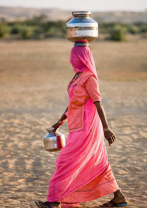 Indian women wearing sari's in the Thar desert. Rajasthan. by Hugh Sitton for Stocksy United