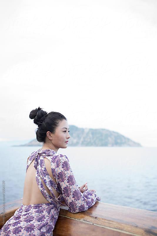 Girl looks forward away at the seaside by Song Heming for Stocksy United