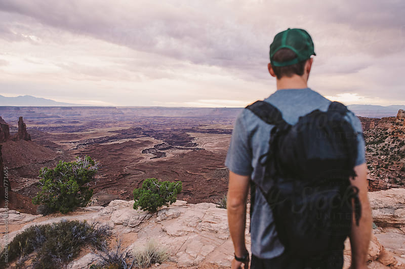 Man Overlooking a Desert Canyon by michelle edmonds for Stocksy United