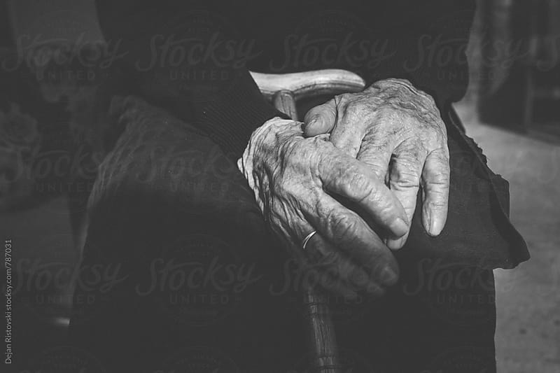 Senior woman old hands with cane by Dejan Ristovski for Stocksy United