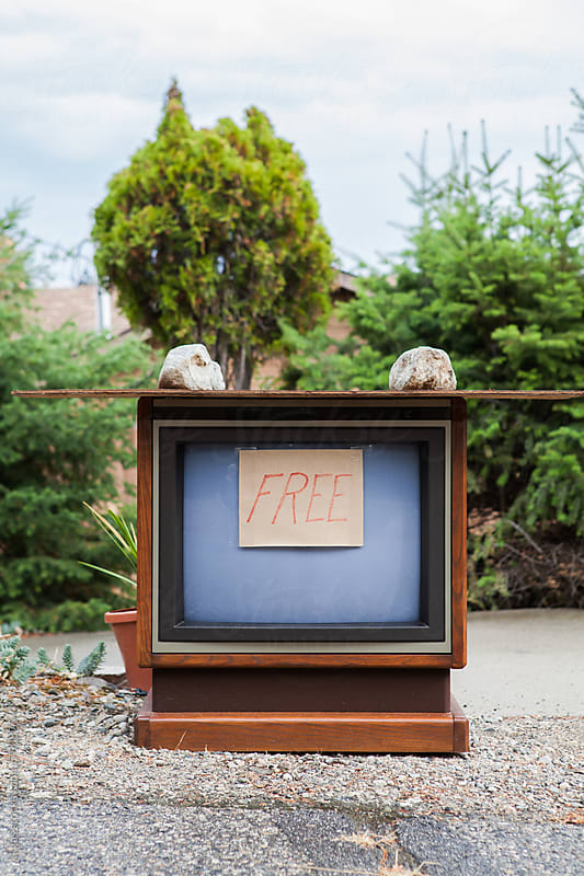 Old Television with 'free' sign on it, in the street. by kkgas for Stocksy United