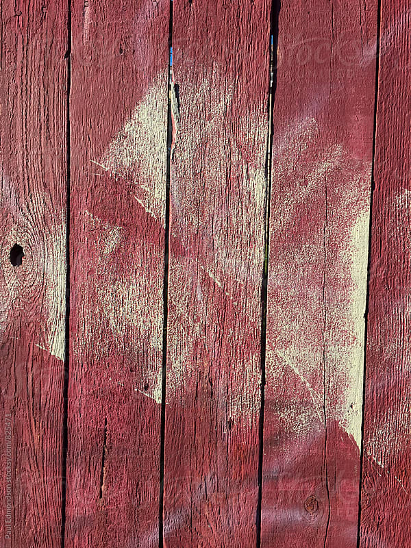 Paint covering graffiti markings on wood fence by Paul Edmondson for Stocksy United