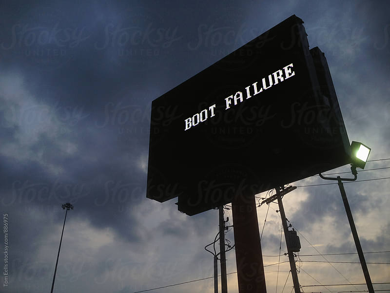 LED billboard sign displaying error message by Tom Eells for Stocksy United