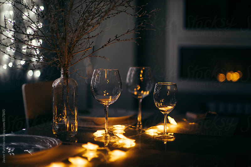 christmas dinner with wine  by Javier Pardina for Stocksy United