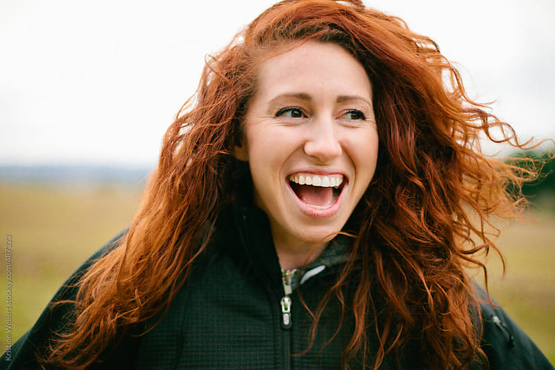 Laughing Woman with Red Curly Hair by Kristine Weilert for Stocksy United