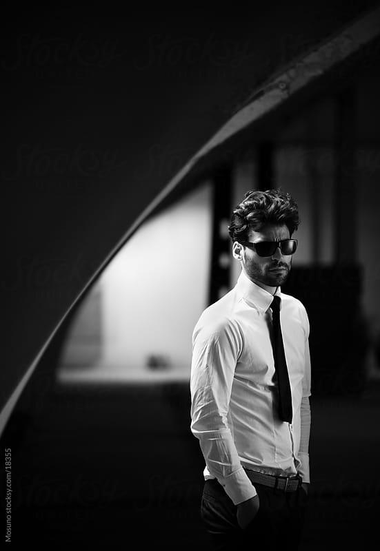 Elegant male model posing in dark hallway.  by Mosuno for Stocksy United