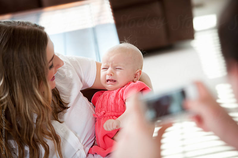 Baby: Taking a Photo of a Crying Baby by Sean Locke for Stocksy United