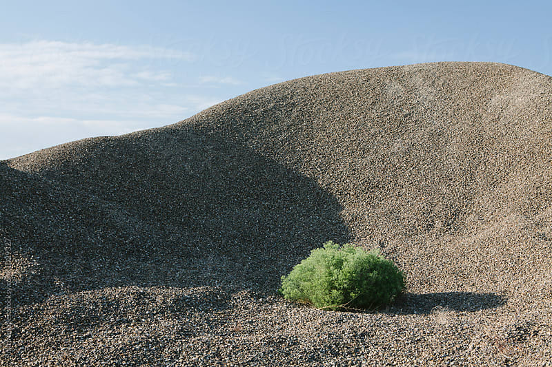 Gravel pile and sagebrush, near Wendover, UT by Paul Edmondson for Stocksy United