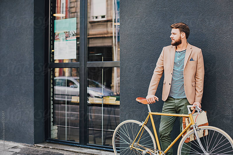 Man With a Bike on the Street by Lumina for Stocksy United