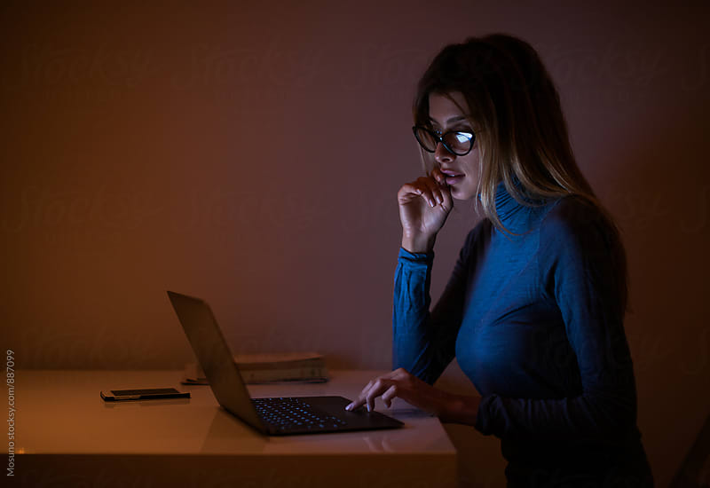 Young Woman Working at Home at Night by Mosuno for Stocksy United
