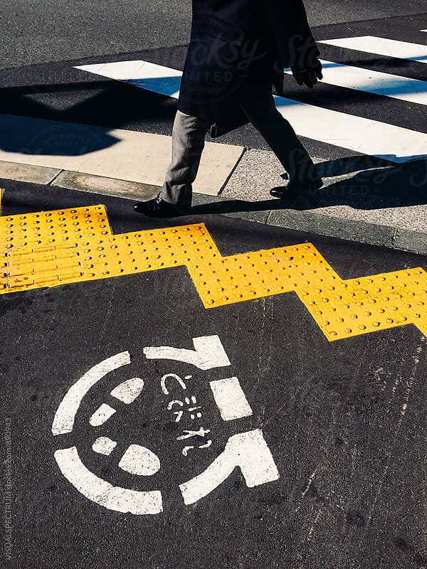Japanese Businessman Crossing Street in Tokyo by VISUALSPECTRUM for Stocksy United