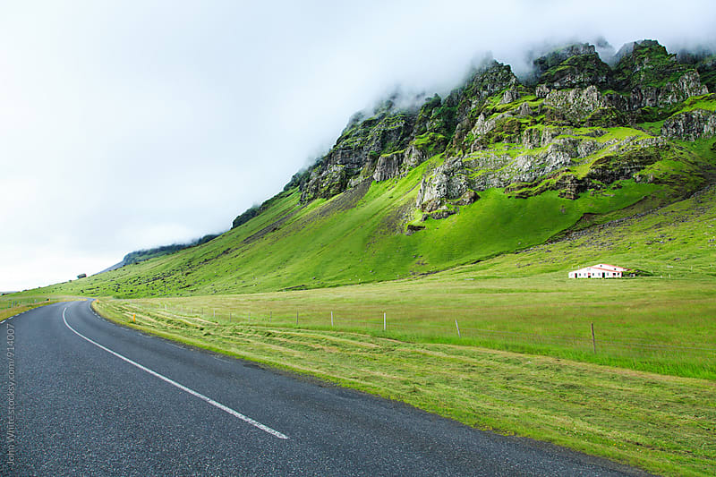 The ring road and mountain range on the South coast of Iceland. by John White for Stocksy United