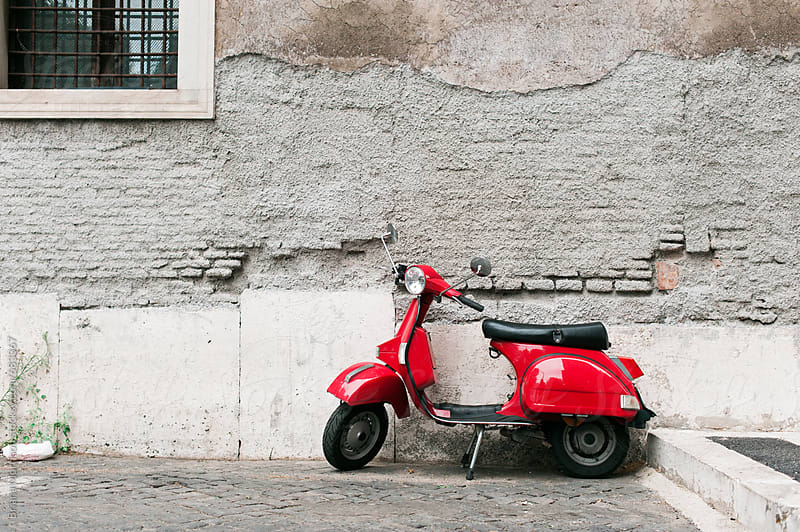 Bright Red Retro Scooter Moped Parked Against an Old Wall in Rome, Italy by Briana Morrison for Stocksy United