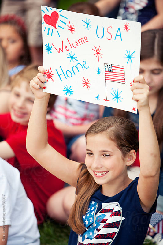 Parade: Young Girl Welcomes Home Military by Sean Locke for Stocksy United
