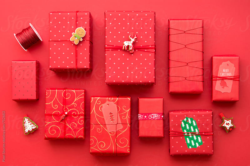 Red themed Christmas presents by Pixel Stories for Stocksy United
