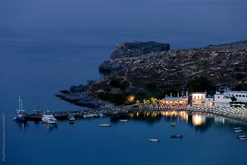 Tranquil scene at dusk over Lindos Bay, Rhodes, Greece by Paul Phillips for Stocksy United