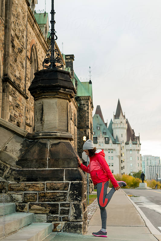Young Woman Stretching for Jogging In Ottawa On Parliament Hill by JP Danko for Stocksy United