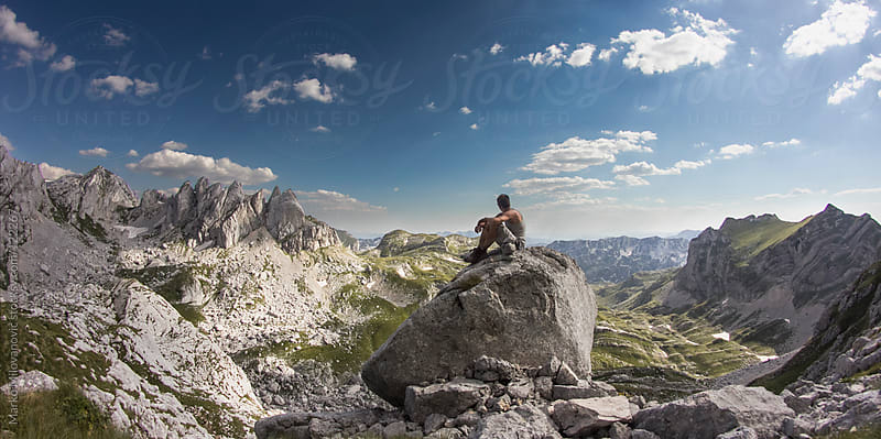 Young climber resting on mountain hiking, enjoying the view by Marko Milovanović for Stocksy United