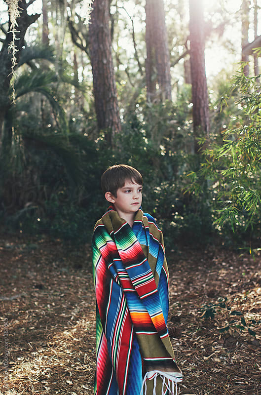A Boy in a Blanket by Ali Deck for Stocksy United