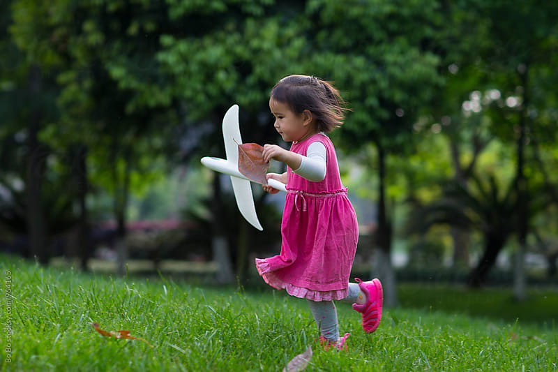 lovely little asian girl running outdoor in the park by cuiyan Liu for Stocksy United