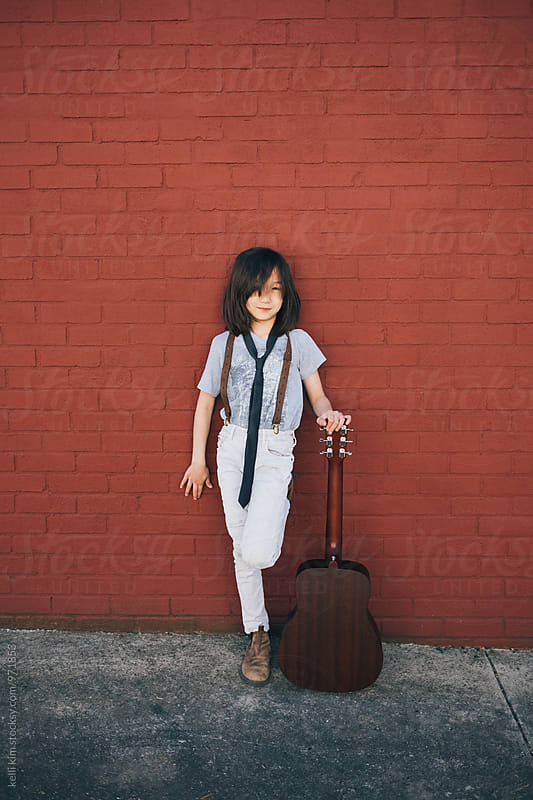 Young boy with his guitar by Kelli Seeger Kim for Stocksy United