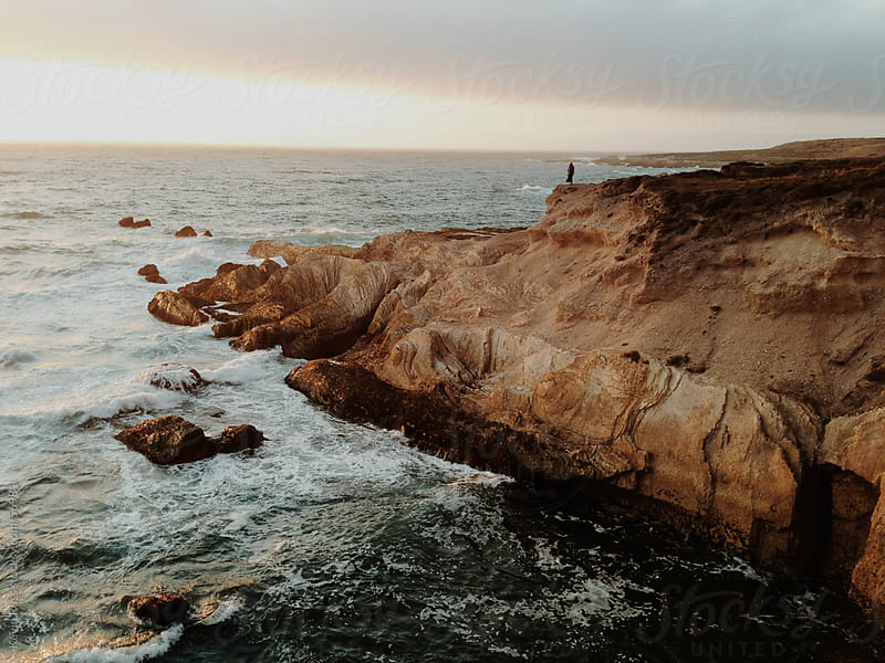Woman Standing on Coast Edge by Kevin Russ for Stocksy United