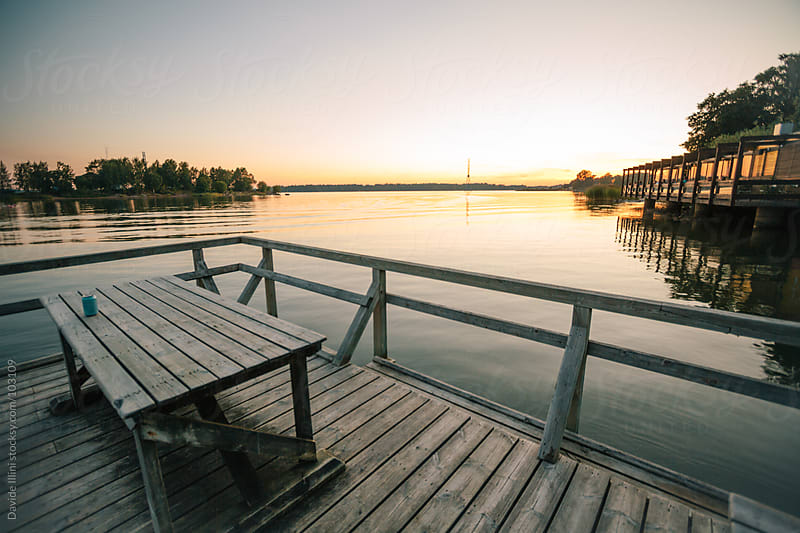 Sunset over the bay of Helsinki in Finland by Davide Illini for Stocksy United