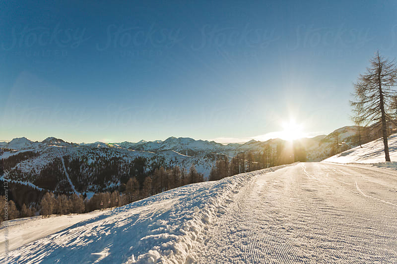 Skiing slopes at sunrise by Leander Nardin for Stocksy United