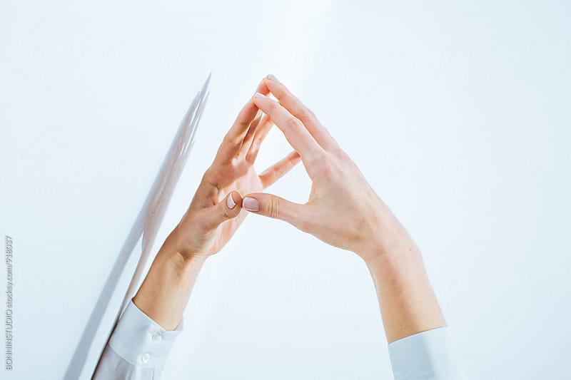 Female's hand over white background. by BONNINSTUDIO for Stocksy United