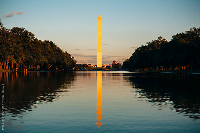 The Washington Monument and Reflecting Pool at dusk by Paul Edmondson for Stocksy United