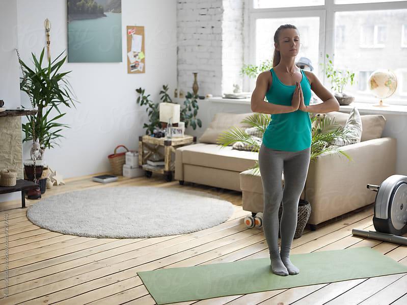 Sportswoman in yoga meditation pose by Milles Studio for Stocksy United