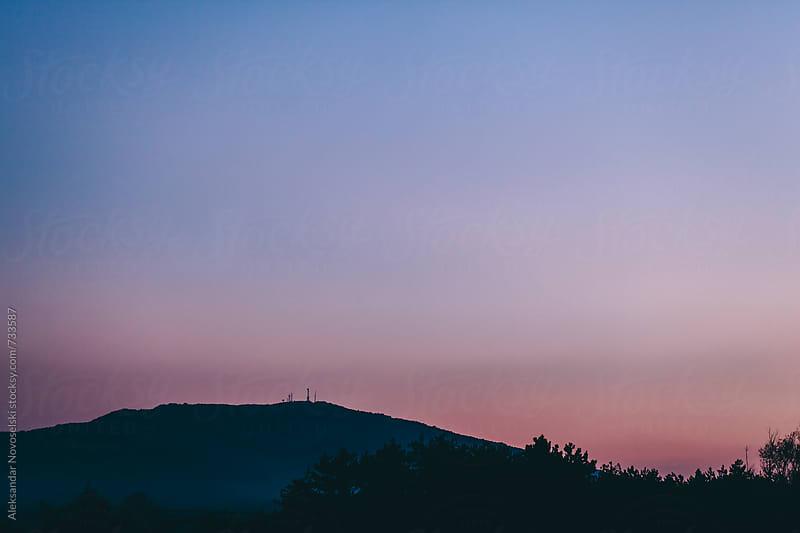 Mountain landscape by dusk with nice pink-blue sky by Aleksandar Novoselski for Stocksy United