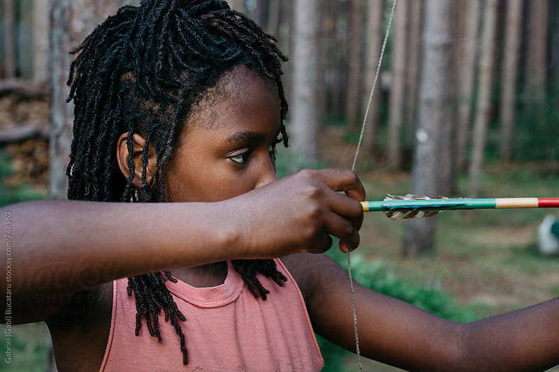African American girl with bow and arrow by Gabriel (Gabi) Bucataru for Stocksy United