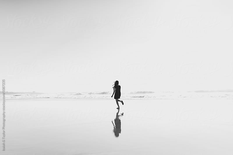 Woman Beach Silhouette by Isaiah & Taylor Photography for Stocksy United