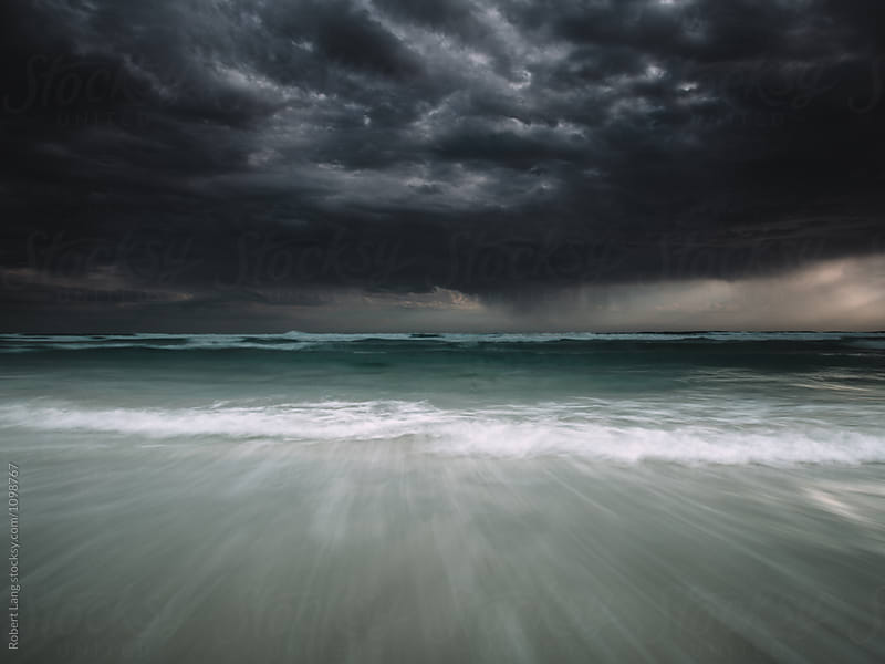 Stormy weather on a coastal beach by Robert Lang for Stocksy United