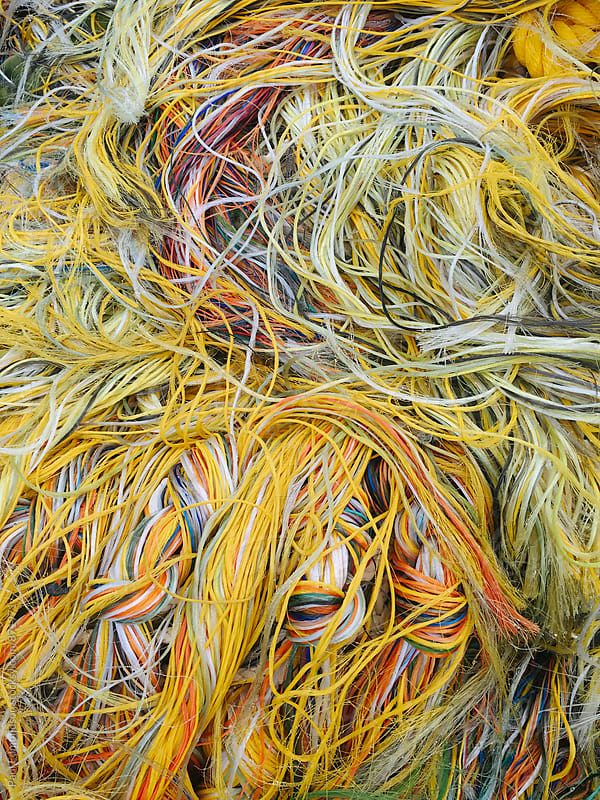 Close up of pile of colorful ropes and commercial fishing nets by Paul Edmondson for Stocksy United
