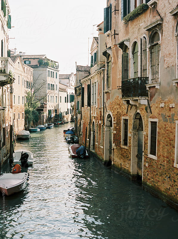 Looking down a canal from a bridge in Venice by Kirstin Mckee for Stocksy United